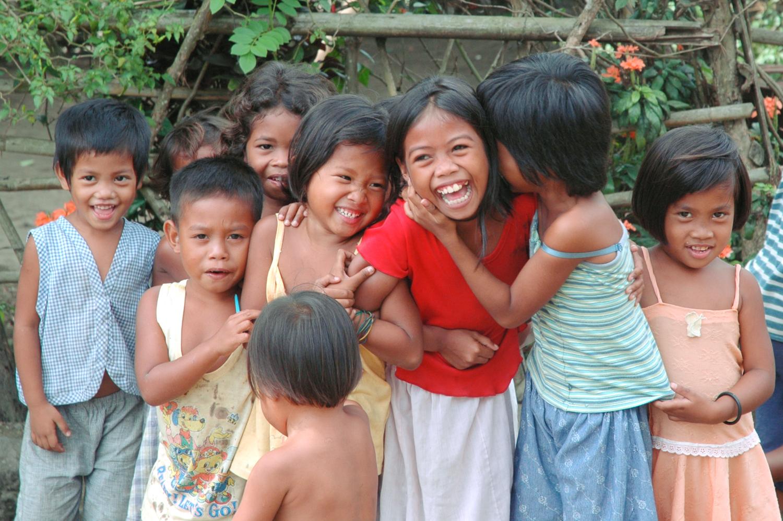 Filipino kids smiling and laughing